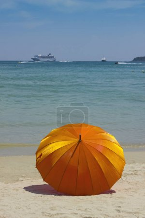 Orange umbrella on the beach