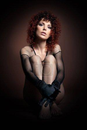 Photo pour Erotic photo, beautiful sexual redheaded girl in erotic cloth - image libre de droit