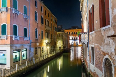 Photo for Venice, Italy - Sep 30, 2018: view into a small canal in Venice at night - Royalty Free Image