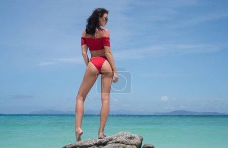 Beautiful girl on paradise beach