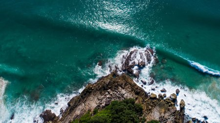 Aerial view of rocks and sea waves