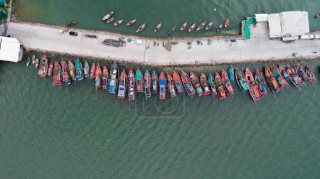 Aerial drone top view of tour and fishing boats morred on the pier in Pattaya, Thailand