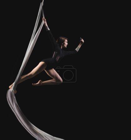 Acrobat woman in gymnast suit