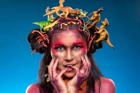 woman with toys dinosaurs in hair