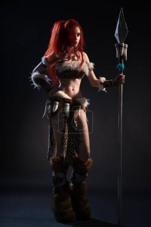 woman in stone age clothing with spear