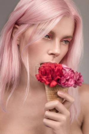 woman with pink hair and icecream flowers