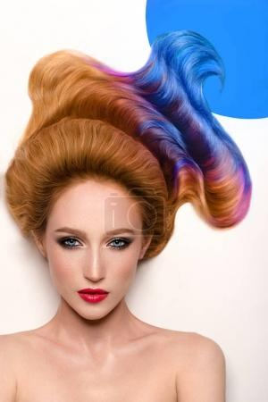 woman with colorful hair in blue circle