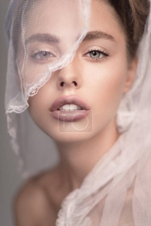 Portrait of woman with brown hair and wedding veil