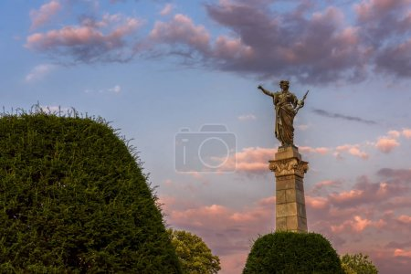 Photo for Ruse, Bulgaria - July 17, 2017: The Monument of Liberty - female figure standing on pedestal and holding a sword in her left hand - one of the symbols of Ruse - Royalty Free Image