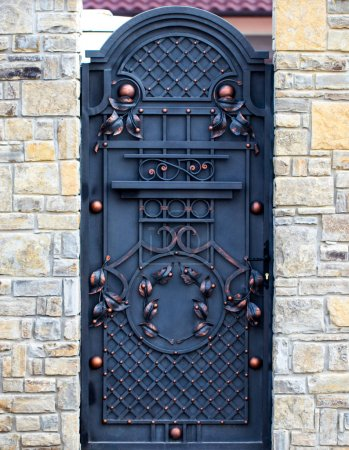 wrought-iron gates, ornamental forging, forged elements close-u