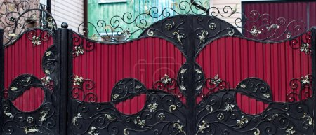 Photo for Wrought-iron gates, ornamental forging, forged elements close-up. - Royalty Free Image