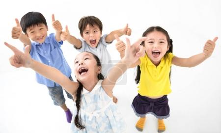 Photo for Group of happy smiling kids with thumb up - Royalty Free Image