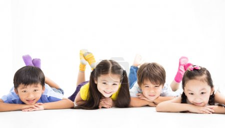 Photo for Happy kids lying on the floor - Royalty Free Image