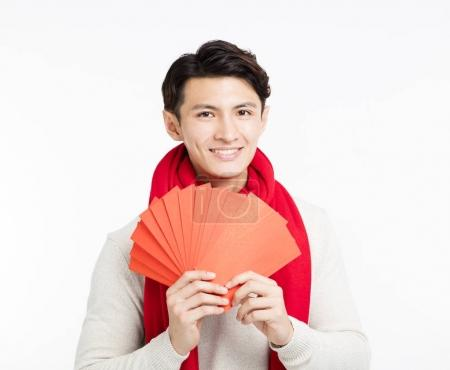 Photo for Smiling asian man showing the red envelope - Royalty Free Image