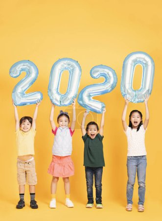 Photo for Group of happy kids celebrating and showing 2020 new year concepts - Royalty Free Image