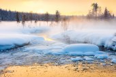 Winter sundown in forest and river with beautiful misty fog