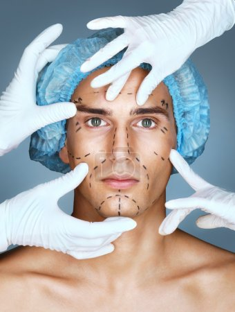 Young man with many surgical hands