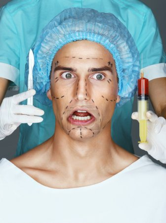Nurse with syringe and scalpel near the face of the scared patient.
