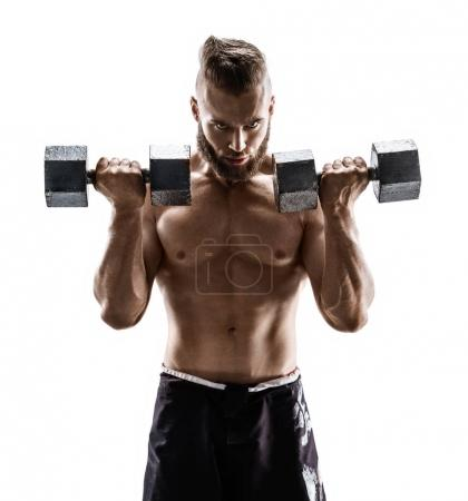 Photo for Handsome guy doing exercises with dumbbells at biceps. Photo of strong male with naked torso isolated on white background. Strength and motivation. - Royalty Free Image