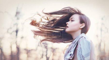 girl wirh hair flying in wind