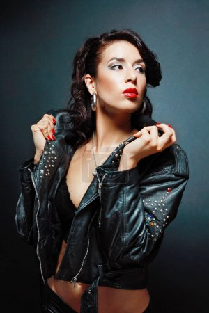 passionate woman wearing leather jacket