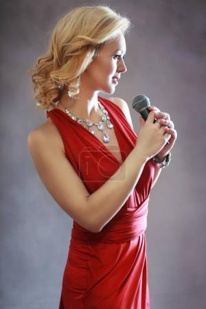 woman in red with microphone