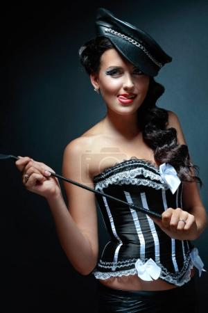 brunette woman flirting holding whip