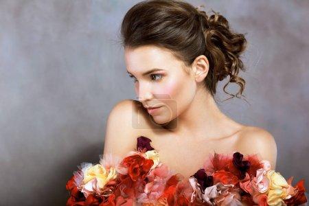 woman in dress of flowers looking away