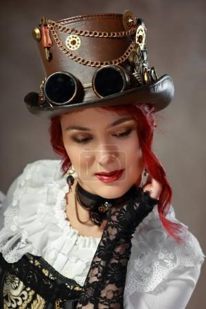 redhead woman wearing vintage hat