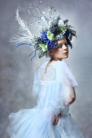 Winter Fairy or Snow queen - woman in light blue tulle dress outdoor wear floral crown