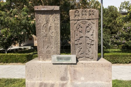 Stone cross in Echmiadzin (Vagharshapat) made of red stone tufa.