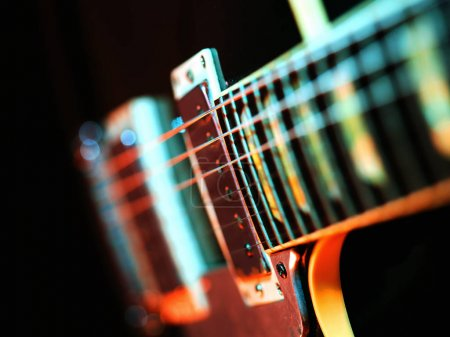 Photo for Closeup macro photo of the pickups and fretboard on an electric guitar - Royalty Free Image
