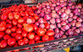 Tomatoes and red onions at a market