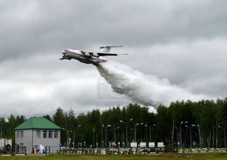 "Fire-fighting aircraft IL-76TD drops water over the range of the Noginsk rescue center EMERCOM of Russia at the International Salon ""Integrated Security-2017""."