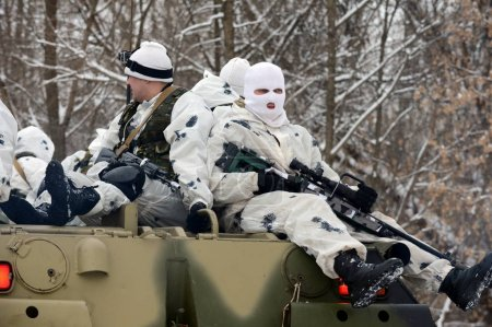 Soldiers special unit on the armored personnel carrier in the winter.