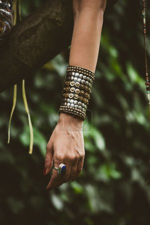 ring and massive bracelet on woman hand