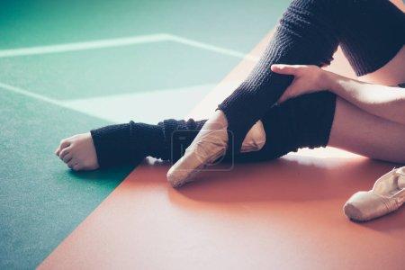 dancer woman putting on ballet shoes closeup