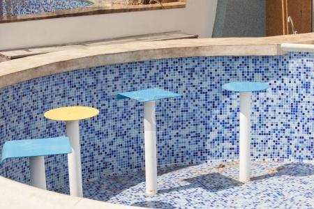 chairs in empty tiled pool