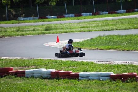 young man drive go kart on track