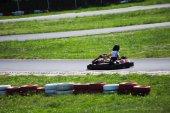 man drive go kart on track