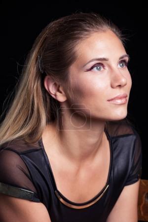 beauty portrait of blonde girl with wet eye shadow