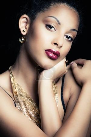 beauty portrait of a sensual glamorous young African woman studi