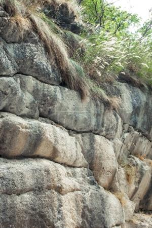 layers of rocks in a small mountain canyon