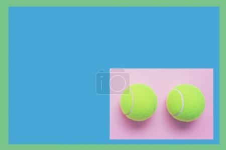 tennis balls on pastel  background minimalism
