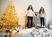 Mother and daughter in Christmas have fun