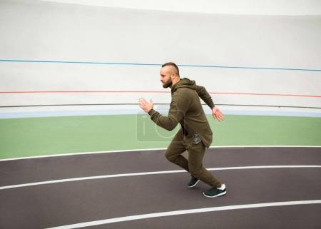 guy on the street doing workout on stadium