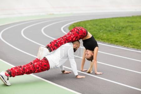 guy and girl on the street doing workout