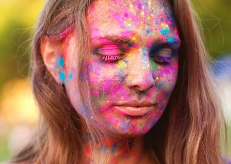 portrait of a girl all face in paint celebrate a festival of pai