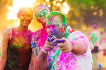 Photo for Guys with a girl celebrate holi festival - Royalty Free Image