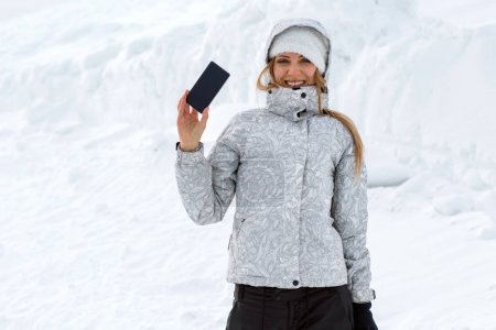 tourist makes selfies on a high mountainside